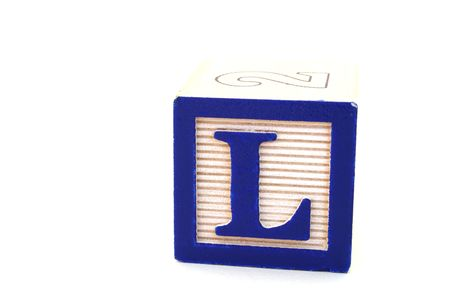 wood block: letter l in an alphabet wood block on a white surface Stock Photo