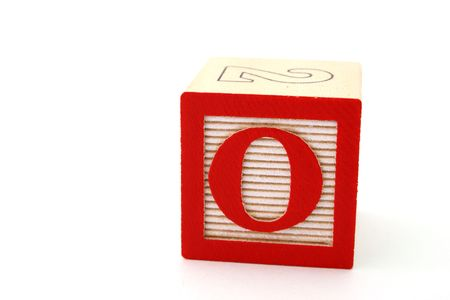 letter o in an alphabet wood block on a white surface