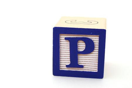 letter p in an alphabet wood block on a white surface photo
