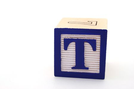 letter t in an alphabet wood block on a white surface Stock Photo