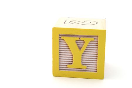 letter y in an alphabet wood block on a white surface
