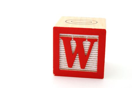 letter w in an alphabet wood block on a white surface Stock Photo