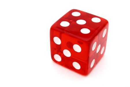 tricky: red tricky die with all sides giving five over a white surface Stock Photo
