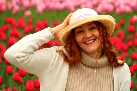portrait of a beautiful young woman on a garden of tulips Stock Photo - 3052126