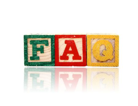 alphabet wood blocks over a reflective surface forming the word faq photo