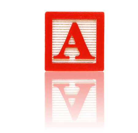 letter a in an alphabet wood block on a reflective surface