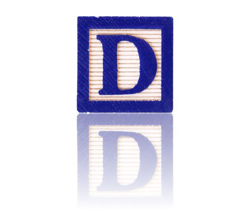 letter d in an alphabet wood block on a reflective surface Stock Photo