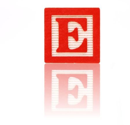reflective: letter e in an alphabet wood block on a reflective surface