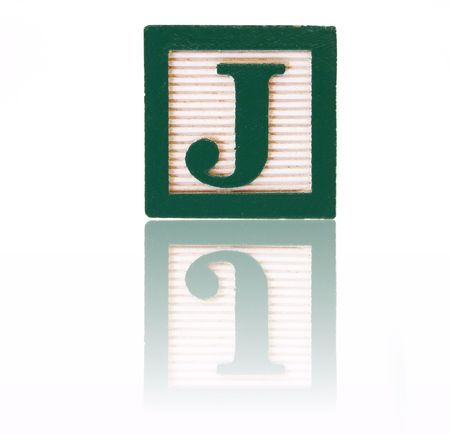 letter j in an alphabet wood block on a reflective surface Stock Photo - 3098955