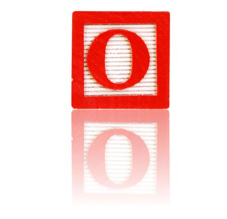 reflect: letter o in an alphabet wood block on a reflective surface Stock Photo