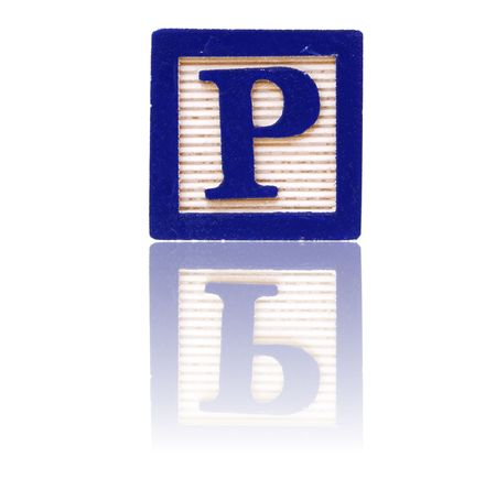 letter p in an alphabet wood block on a reflective surface Stock Photo