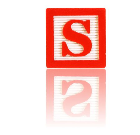 letter s in an alphabet wood block on a reflective surface Stock Photo