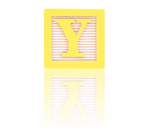 letter y in an alphabet wood block on a reflective surface Stock Photo