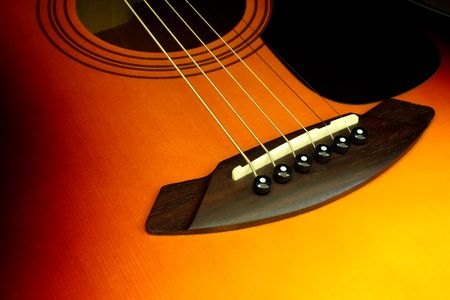 detail view of the bridge and strings of an acoustic guitar Stock Photo - 3239936