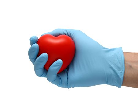 hand in latex blue gloves holding a toy heart isolated in white Stock Photo