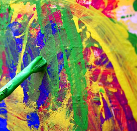 close up on a brush over an abstracting painting photo