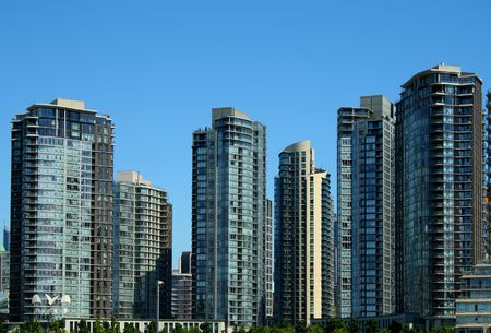 modern residential and commercial buildings under a clear blue sky
