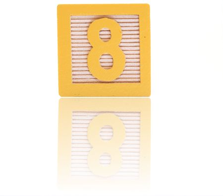number eight in an alphabet wood block on a reflective surface Stock Photo - 6543972