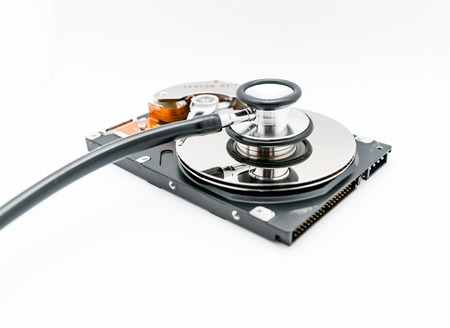 disco duro: Harddisk and stethoscope - concept for repair and restore a harddrive Foto de archivo