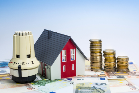 save heating costs: Thermostat with euro money - concept picture for heating costs Stock Photo