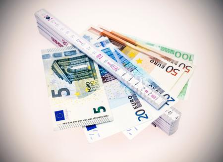 Yardstick and euro money Stock Photo
