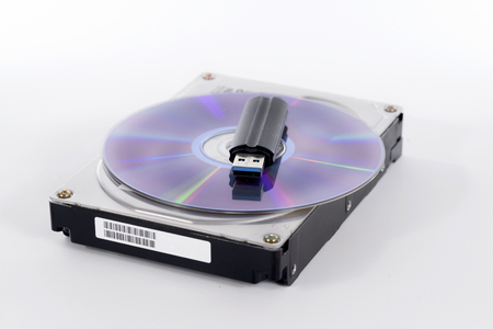 Stack of harddrive, compact disc and USB stick Stock Photo