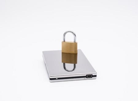USB harddirve with padlock on white background