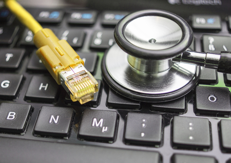 dsl: Network Cable and Keyboard Stock Photo