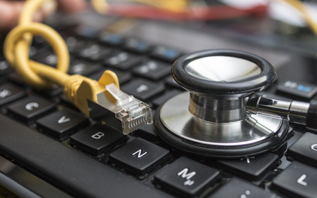 bandwidth: Network Cable and Keyboard Stock Photo