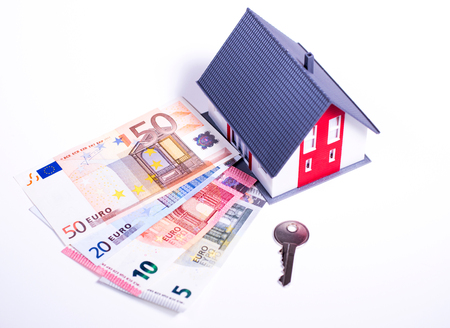 Model house and money for project Stock Photo