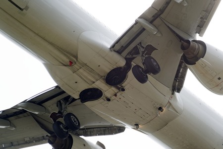 The underside of a modern airplane and its landing gear