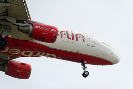 20th of June 2017 Berlin, Germany: The underside of a modern airplane and its landing gear fron the airline Airberlin. Landing at the airport Berlin-Tegel Editorial