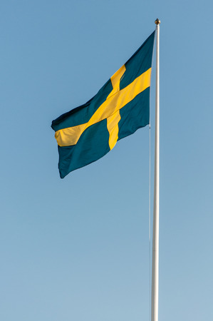 The flag of Sweden waving in the wind photo