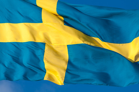 Flag of Sweden waving in the wind photo