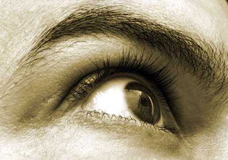 lacrimal: Right eye showing the eyebrow and the eyelid with reflection of a building across the eyeball Stock Photo