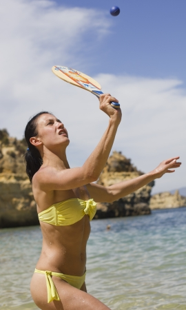Young woman paying beach tennis photo