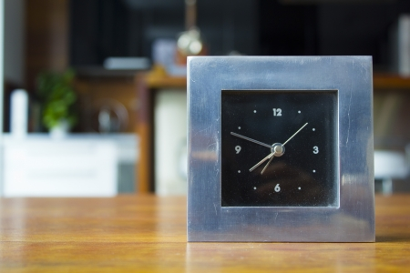 Clock on the table Stock Photo - 22554381