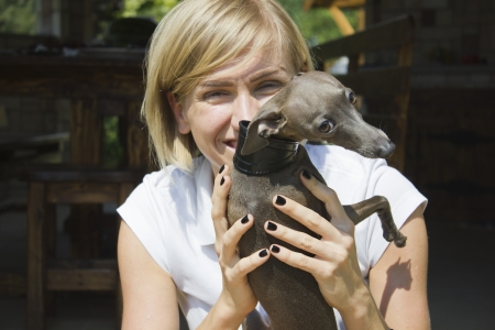 bluster: Young woman hugging with dog