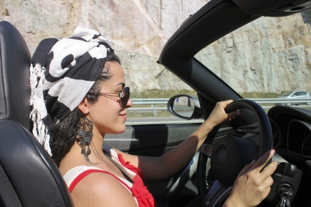 Beautiful woman driving a roadster photo