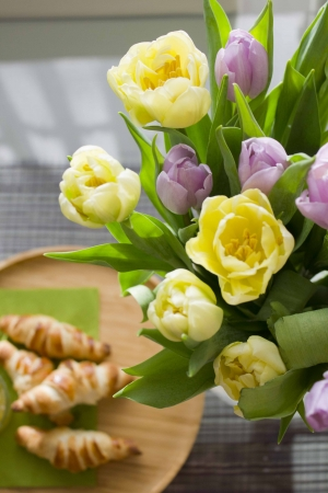 Tulips and croissants photo