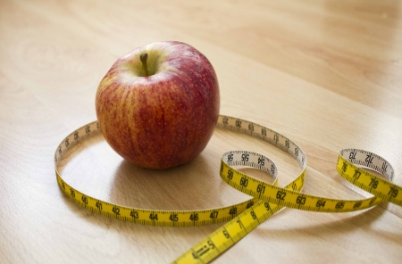 Apple wrapped with measuring tape