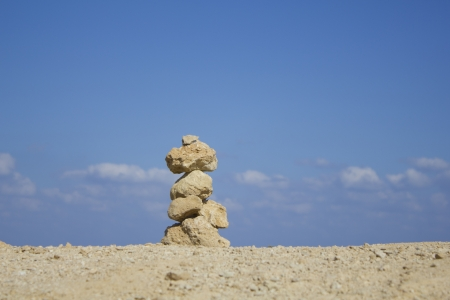 verticals: A stone stack against a blue sky