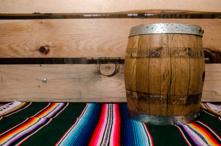 old barrel over a mexican tapete Stock Photo