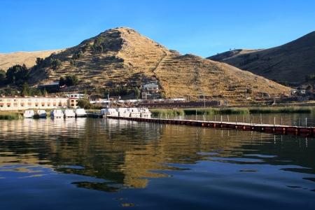 blu sky: Beautiful pyramid and titicaca lake in Puno, Peru  Peruvian andes