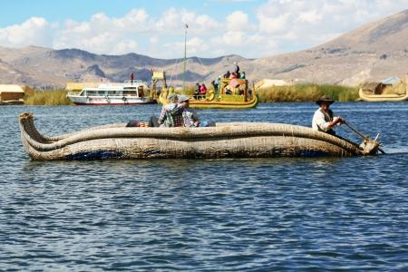 indios: Traditional uros boat, in uros island, Puno, Peru  Peruvian andes