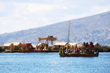 Peru, floating Uros islands on the Titicaca lake, the largest high altitude lake in the world  Theyre built using the buoyant totora reeds that grow abundantly in the shallows of the lake