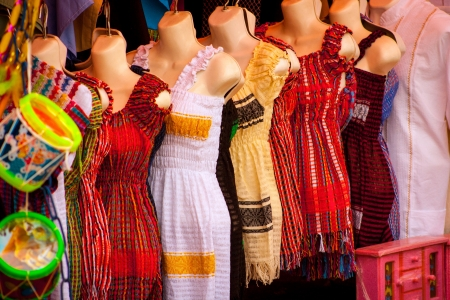 Sell of beautiful colorful mexican dresses at Xohimilco, Mexico. 免版税图像