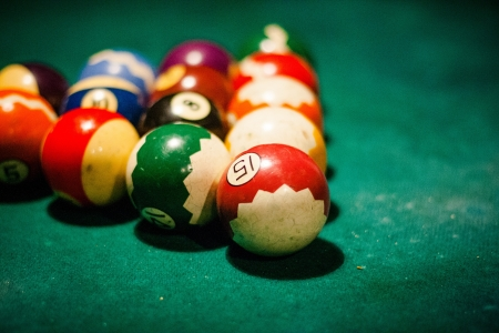Close up of billiard table with balls in entertainment club Archivio Fotografico