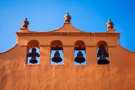 church bells: Facade of an old church with a bellfry Stock Photo
