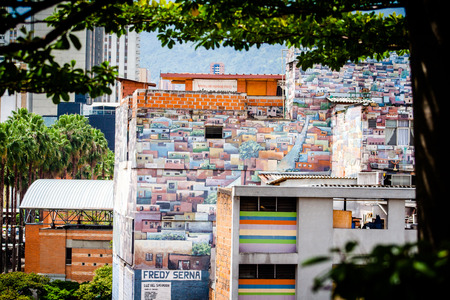 comuna: House with a paint of a favela comuna in medellin colombia Editorial